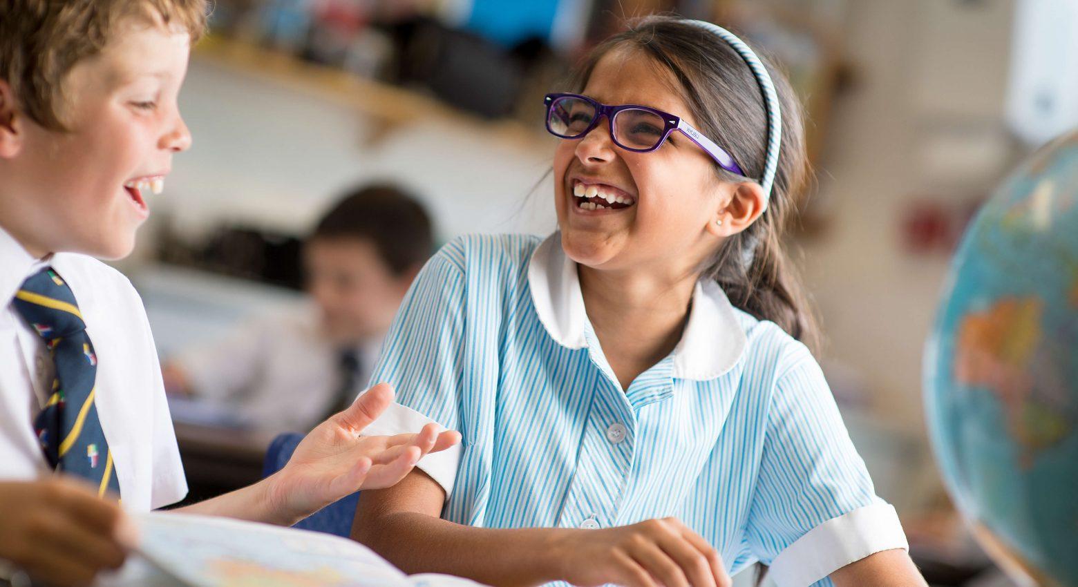 school children laughing in classroom
