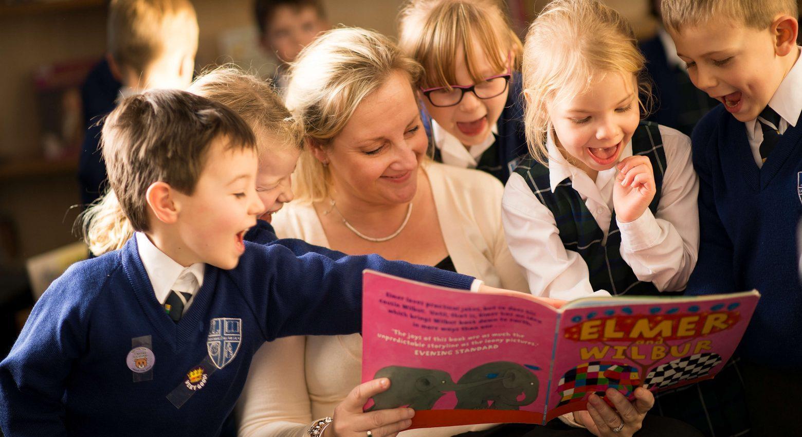 children reading with teacher