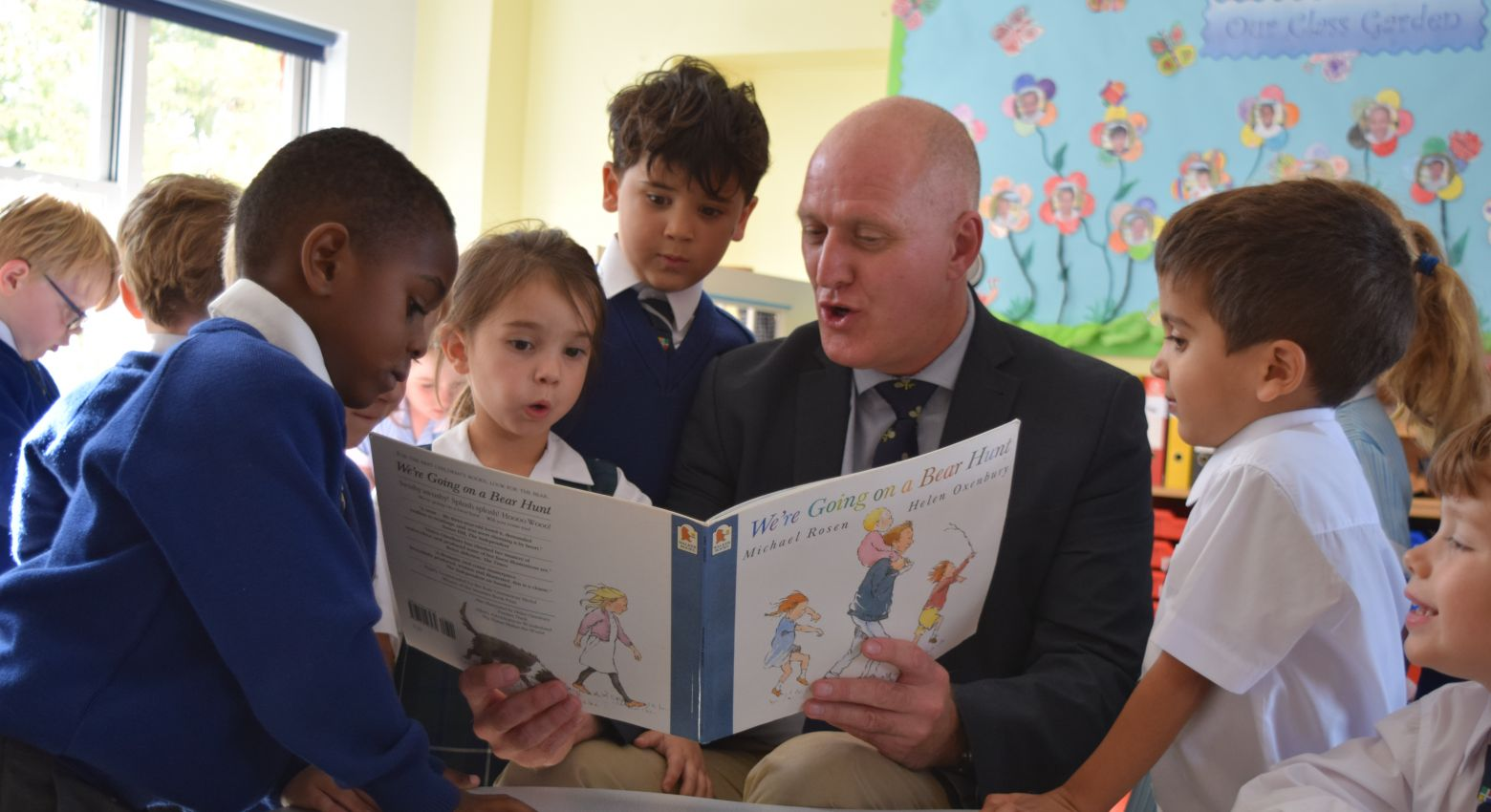 Headteacher reading to students