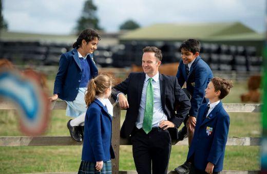 school children standing with Head teacher