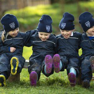 four children enjoying outdoor play